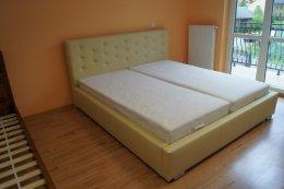 Tapicerowane łóżko Savana 160x200 ze stelażem i materacem kieszeniowym