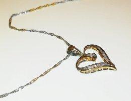 Złota zawieszka z diamentami 0,48ct i dwukolorowym, złotym łańcuszkiem